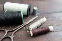 Sewing tools on the old wood Stock Image