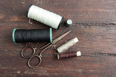 Sewing tools on the old wood Stock Photos