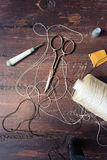 Sewing tools on the old wood Royalty Free Stock Photos
