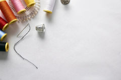 Sewing tools on white fabric background top view diagonal set Stock Photos