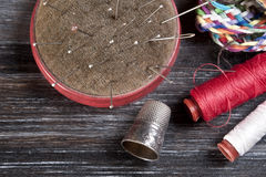 Sewing tools. On wooden surface stock image