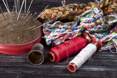 Sewing tools. On wooden surface royalty free stock photography