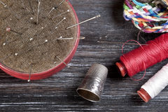 Sewing tools. On wooden surface stock images