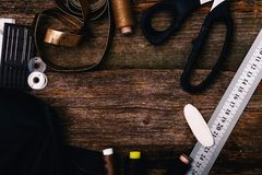 Sewing. Tools on the wooden table royalty free stock photography