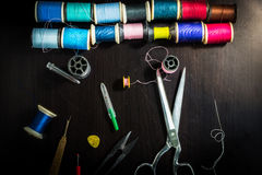 Sewing tools on a wooden table. Royalty Free Stock Photo
