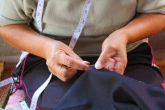 Women are sewing, tribal dress, Phuthai dress Stock Image