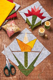 Sewing two patchwork blocks of flowers from quilt fabric Royalty Free Stock Image