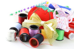 Sewing utensils - coils colored threads Stock Photo