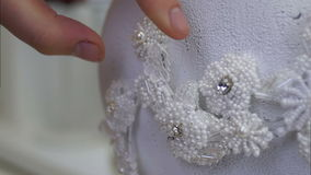 Sewing of wedding hair accessory made of white lace stock footage