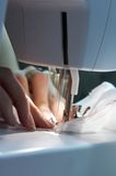 Sewing woman. Fingers. Rapid moving needle Stock Photo