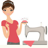Sewing woman. Woman seamstress with sewing machine Stock Photos