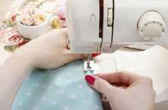 Sewing woman Stock Image