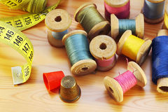 Sewing on wooden table Royalty Free Stock Images