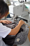 Sewing worker stock photo