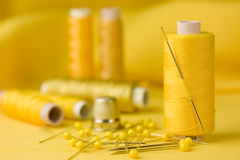 Sewing yellow Stock Image