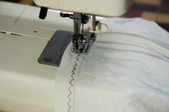 Sewing Zigzag at the white shirt royalty free stock photo