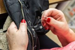 Sewing the zipper stock image