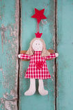 Sewn angel doll hanging on turquoise wood board - christmas Stock Photos