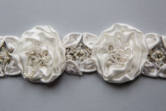 Sewn braid white color in the form of fabric flowers Stock Photo