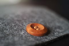 Sewn button playing with light. Shadow, reflection and surfaces, selective focus Royalty Free Stock Photography
