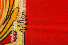 Sewn cloth background. In orange yellow and red Stock Photos