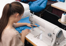 Sews on the sewing machine Stock Photography