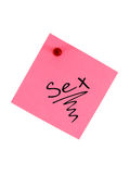 Sex. Sign written on the pink piece of paper, attached to the notice board, isolated on white background royalty free stock photography
