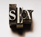 Sex. The word Sex done in old lead type. Cross-processed for a unique look royalty free stock photography