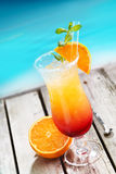 Sex on the beach Cocktail. On wooden planks in front of a blue swimming pool or the ocean. For Drinkable Concepts visit my Portfolio royalty free stock image