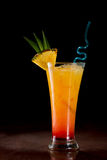 Sex on the beach. Cocktail served on a bar garnished with a pineapple slice Stock Photography