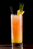 Sex on the beach. Cocktail served on a bar garnished with a pineapple slice royalty free stock photos