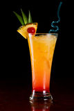 Sex on the beach. Cocktail served on a bar garnished with a pineapple slice and a cherry Royalty Free Stock Photos