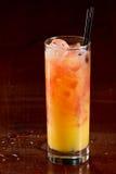 Sex on the beach. Cocktail served on dark a bar Stock Photos
