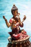 Sex-beväpnat meditera för Buddha Royaltyfria Bilder