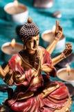 Sex-beväpnat meditera för Buddha Royaltyfri Bild