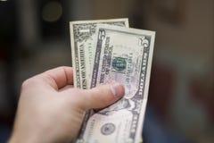 Sex dollar i min hand Royaltyfria Bilder
