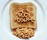 Sex drugs rock roll toast Stock Images