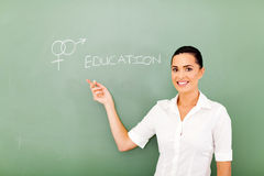 Sex education. Female teacher pointing at sex education written on the chalkboard Stock Photo