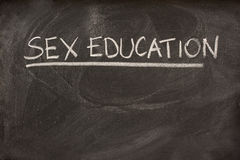 Sex education as a class topic on blackboard. Sex education handritten with white chalk as a class or lecture topic on blackboard Stock Image