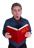 Sex Education, Funny Shocked Man Reading Book. Funny scene of a man reading and learning about sex education and love. Isolated on white. Looking at camera Royalty Free Stock Images