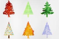 Sex färgrika julträd Arkivfoto