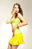 Sex girl in a yellow dress Royalty Free Stock Photography