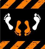 Sex legs silhouettes on hazard stripes texture Stock Image