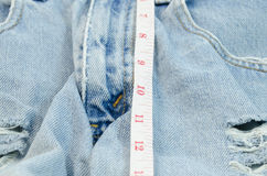 Sex length. Jeans pants and tape measure Royalty Free Stock Photography