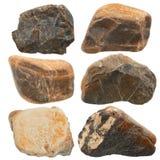 sex naturliga stenar som isoleras på vit Arkivbilder