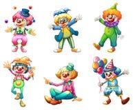 Sex olika clowndräkter Arkivbild