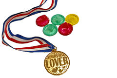 Sex olympics. Five condoms in a form of olympics with a worlds best lover medal Stock Image