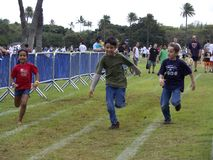 Sex race. Boys vs. girl, parents vs. children,  raced against the clock at the 2008 Pro Bowl Festival held at Kapi'olani Park, beneath Diamond Head, in Waikiki Royalty Free Stock Photo