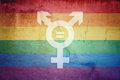 Sex rights as a metaphor of social issue. No discrimination LGBT flag and transgender symbol with equal sign inside painted over a cracked concrete wall stock illustration