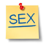 Sex and sexuality symbol. Represented by a yellow office note with a red thumb tack Royalty Free Stock Photography